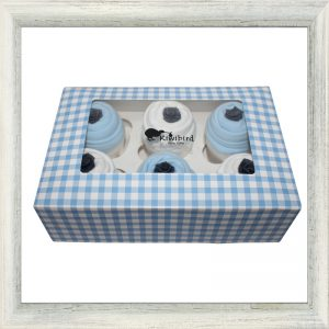 The perfect gift containing 3x 0-3 month bodysuit cupcakes and 3x 3-6 month bodysuit cupcakes in blue and white, topped with a hand crafted paper rose, presented in a beautiful gingham cupcake box