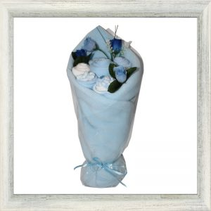 Blue cotton baby garments and blanket handcrafted into a bouquet of flowers.