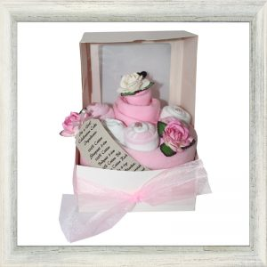 Pink baby blanket, towels and clothes handcrafted to look like a cake.